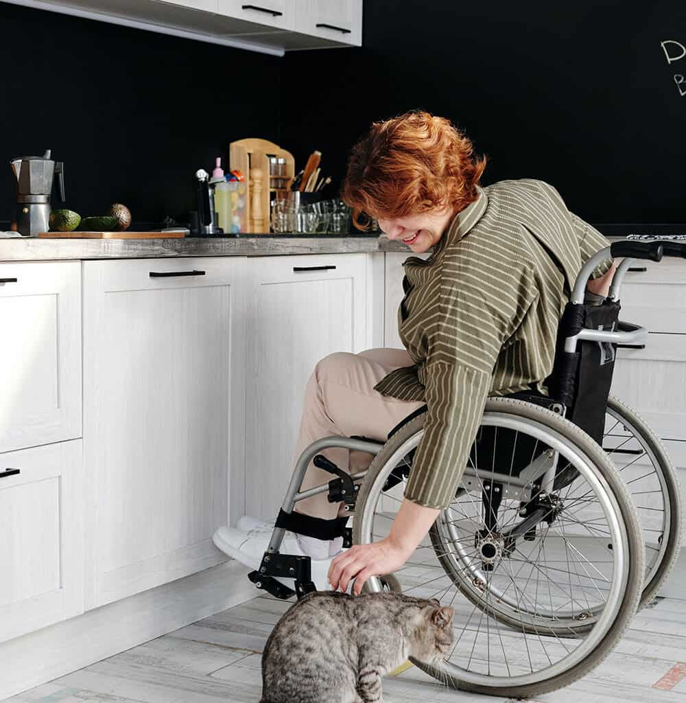Woman with Disability in her kitchen