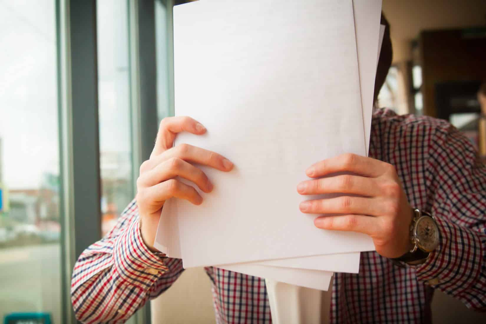 Man shuffling papers into order