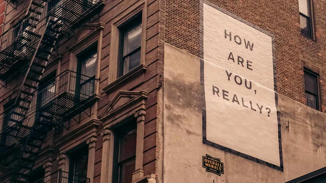 Wall with a sign that asks 'How are you, really?'